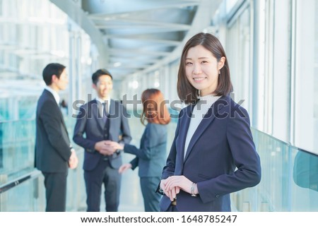 japanese business woman is standing Royalty-Free Stock Photo #1648785247