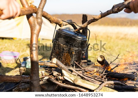 camping bowler on camp fire hiking life style concept picture in outdoor highland space environment  #1648953274