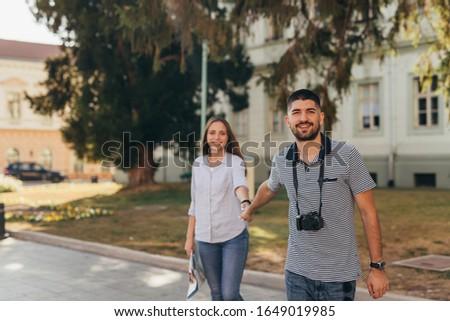 couple tourist exploring new city #1649019985