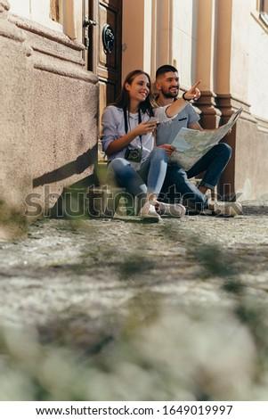 couple tourist exploring new city #1649019997
