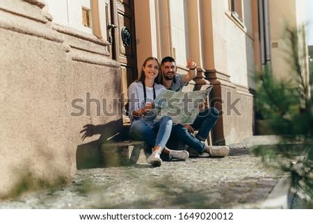 couple tourist exploring new city #1649020012