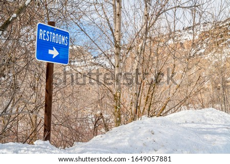 restrooms sign in one of rest areas in Glenwood Canyon, Colorado in winter scenery, travel concept #1649057881