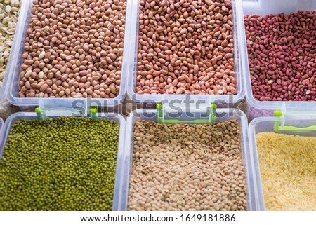general plan of the store counter, with containers filled with a variety of cereals, cereals. Raw cereals. Healthy nutrition, natural nutrition. diet food #1649181886