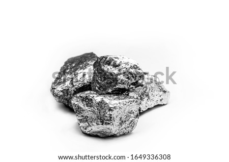 Manganese, manganese, or magnesium stone is a chemical element, it is in the manufacture of metal alloys. Silver colored ore, industrial use. Ore on black isolated background. #1649336308