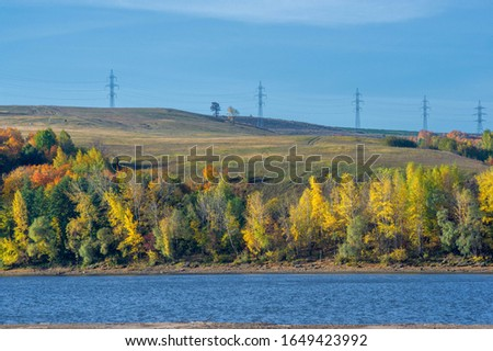 Autumn landscape river sandy shores, rifts and stretches, dark blue cold water, a sad time to catch eyes, a colorful farewell to the summer #1649423992