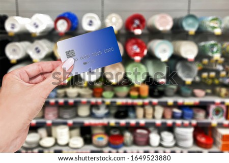 Payment of purchases by card in the store, shop of tablewares. #1649523880