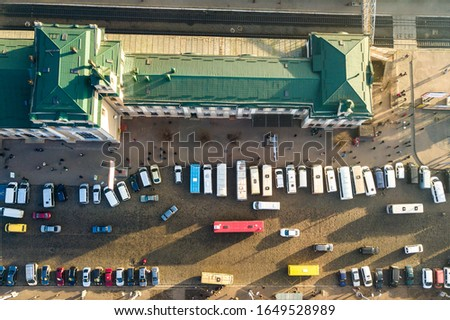 Aerial view of many cars and buses moving on a busy city street in front of railway station building in Ivano-Frankivsk city, Ukraine. #1649528989
