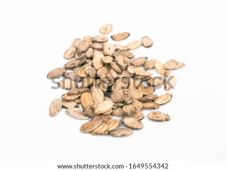 sunflower seeds, watermelon seeds and pumpkin seeds on a white background and wood  #1649554342