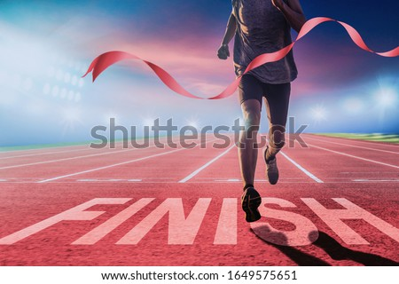 Runners running towards the finish line. Success concept. Royalty-Free Stock Photo #1649575651