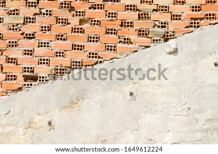 Half rendered brick wall under construction. flemish style. #1649612224