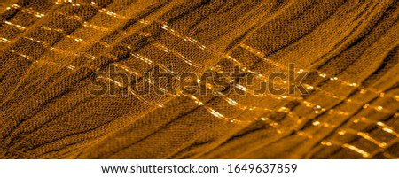 The texture of the background pattern, ornament decor, golden yellow corrugated fabric, fabric with parallel or diagonal folds of serrated folds; products from such a fabric. #1649637859