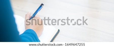 Closeup hand woman writer thinking idea and writing on notebook or diary with happy, lifestyle of asian girl is student, female planning working, education and business, concept. #1649647255