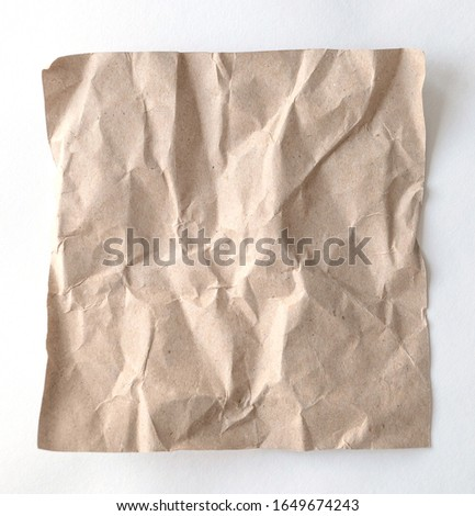 Brown wrinkle recycle paper background. Crumpled brown paper on white background, can use text banners products or business cards. #1649674243