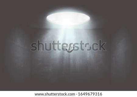 man falling down from a hole of light, surreal concept Royalty-Free Stock Photo #1649679316