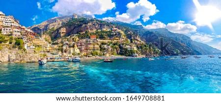 Positano coast , Italy, 2019. Positano village in the mountains. Coastal or coast view. Positano, is a village on the Amalfi Coast, Salerno, Campania. Sea Beach Travel destinations. Europe. Italian.  #1649708881