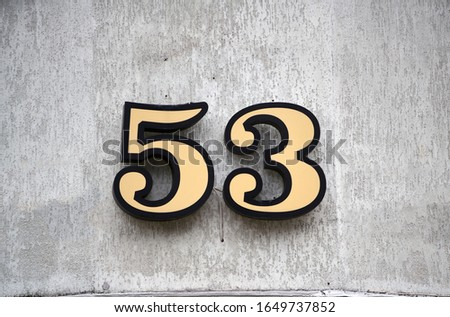House number fifty three, grungy. Royalty-Free Stock Photo #1649737852
