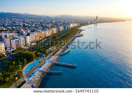 Republic of Cyprus. Limassol promenade from a height. Panorama of the Mediterranean coast at sunset. Sea promenade of Limassol. Molos. Promenade by the Mediterranean sea. Holidays in Cyprus. Royalty-Free Stock Photo #1649741110