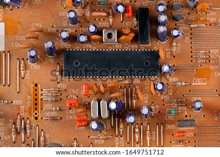 Electronic components on a obsolete printed-circuit board. Top view. #1649751712