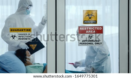 coronavirus covid 19 quarantine and breakout alert sign on window of quarantine room at hospital with coronavirus covid19 disease control experts make disease treatment to coronavirus infected patient #1649775301
