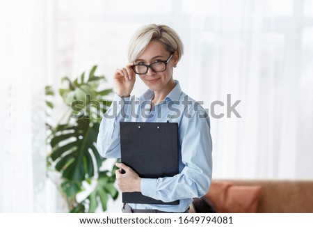 Successful Psychologist. Professional Counselor Lady Holding Folder Smiling To Camera Standing In Office. Royalty-Free Stock Photo #1649794081