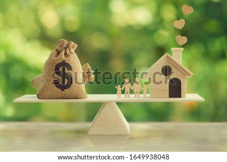 Property investment and house mortgage concept: Wooden home, Family member and US dollar hessian bags on wooden balance scale. depicts family financial management for a residence. #1649938048