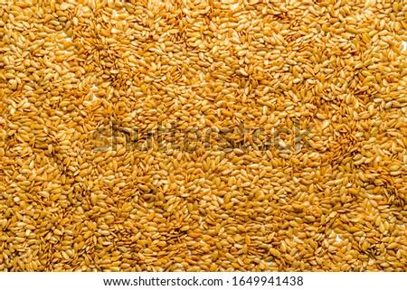 Texture, background flax seeds. Health supplements medicines omega-3, omega-6 omega-9 #1649941438