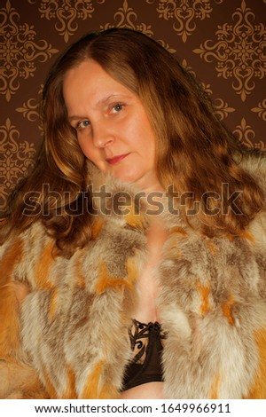 Model shoot with a model in a fur jacket #1649966911