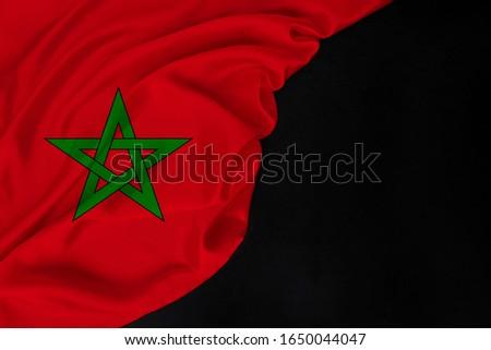 Morocco silk national flag folded in soft folds on black blank form, concept of tourism, economy, politics, emigration #1650044047