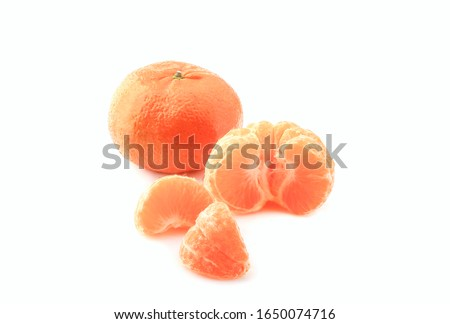 Peeled mandarin and peeled mandarin peeled off on a white background #1650074716