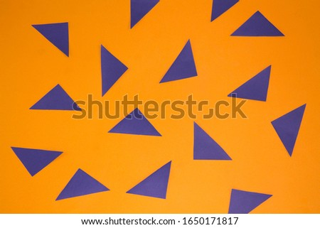 orange background above blue triangles scattered symmetrically