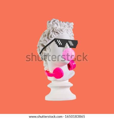 Statue on a pink background. Gypsum statue of Apollo head. Man. Creative. Plaster statue of Apollo head in pixel glasses. Minimal concept art. #1650183865