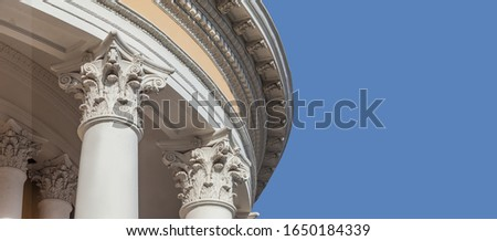 White capitals of columns on a blue background #1650184339