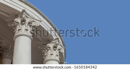 White capitals of columns on a blue background #1650184342