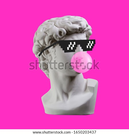 Statue. Earphone. Isolated. Gypsum statue of David's head. Man. Creative. Plaster statue of David's head in pixel glasses. Minimal concept art.