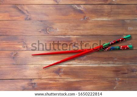 Classic asian wooden chopsticks on desk #1650222814