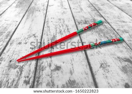 Classic asian wooden chopsticks on desk #1650222823