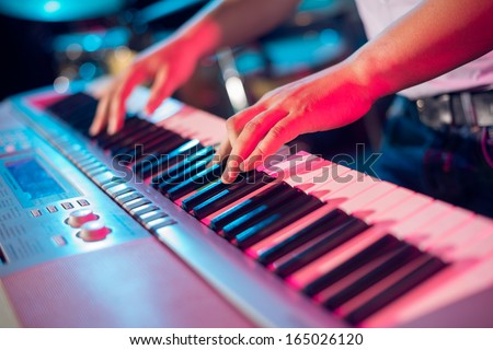 Human hands playing the piano on the party Royalty-Free Stock Photo #165026120