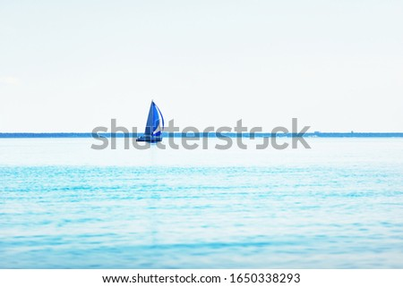 Sailing yacht regatta. Modern sailboats racing with blue spinnaker sails. Clear summer day. Kiel, Germany #1650338293