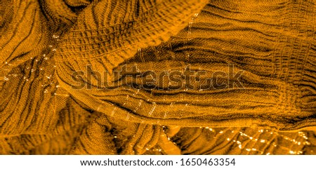 The texture of the background pattern, ornament decor, golden yellow corrugated fabric, fabric with parallel or diagonal folds of serrated folds; products from such a fabric. #1650463354