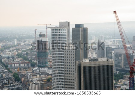 Modern skyscrapers of the developing business center of the metropolis. Construction #1650533665
