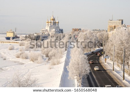 View of the winter city of Arkhangelsk. Beautiful temple, port and icebreakers. Russia, Arkhangelsk #1650568048