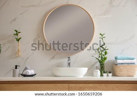 Beautiful green plants near vessel sink on countertop in bathroom. Interior design elements #1650659206