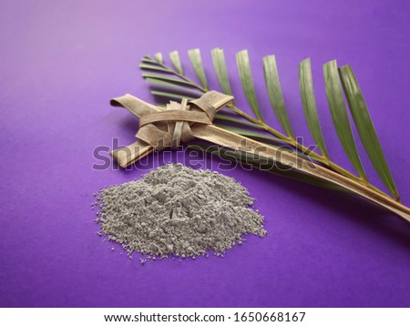 Good Friday, Palm Sunday, Ash Wednesday, Lent Season and Holy Week concept.  Christian crosses made of palm leaves and ashes on purple background. Royalty-Free Stock Photo #1650668167