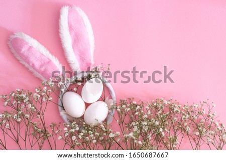 Happy Easter. Flat Lay of easter ears and gypsophila flowers on a pink background. Easter background. Easter concept