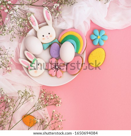 Happy Easter. Multi-colored pastel easter cookies on a pink background. Easter concept