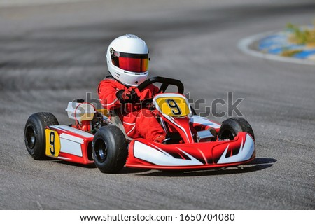Young go cart racer on circuit Royalty-Free Stock Photo #1650704080