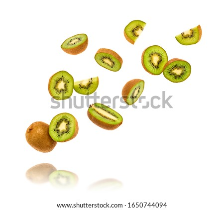 Fresh kiwi fruit flying in air. Fruity green color diet food. Summer whole, cut kiwi background. Colorful levitation concept. Falling fly kiwi, fruity creative vivid design #1650744094