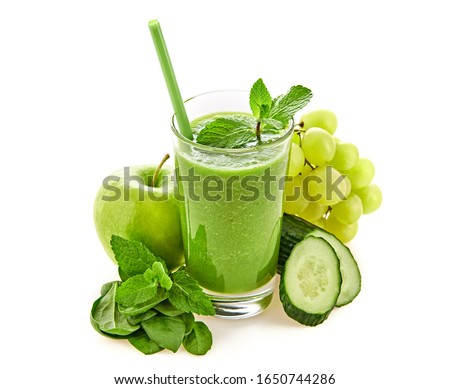 Freshly blended green fruit smoothie in glass, healthy detox vitamin diet food concept. Raw vitamins breakfast smoothie drink. Greens, spinach, apple, cucumber for smoothie isolated on white. #1650744286