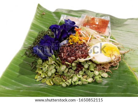 Thai style riceberry salad on banana leaves, boiled eggs, soy beans and pea flowers #1650852115