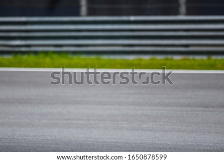 Blur image of race track. Motorsports racing circuit for background. #1650878599